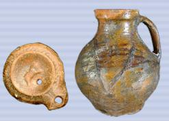 Pottery Roman lamp and medieval jug